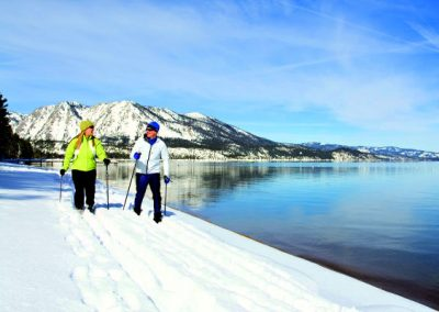 couple cross country skiing in lake tahoe at camp richardson resort