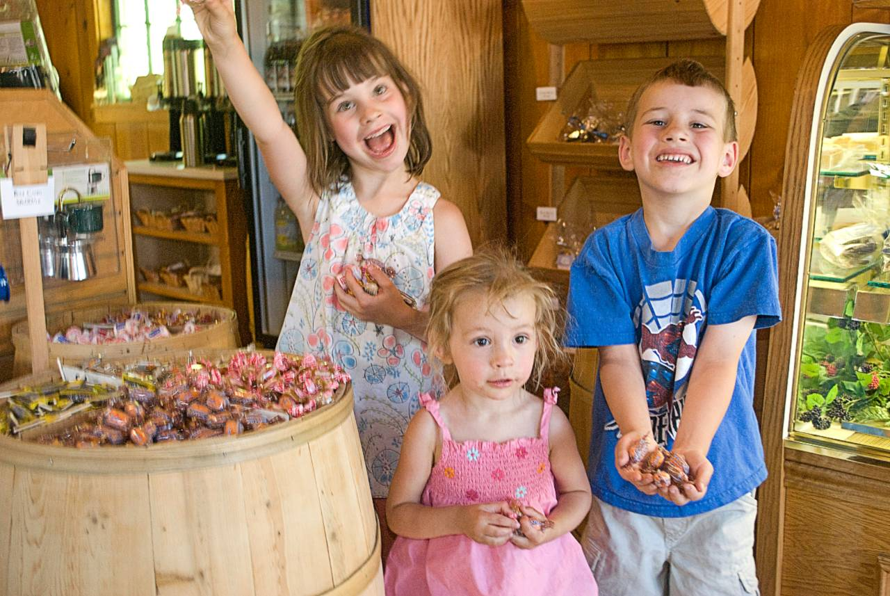 Kids enjoying treats from The Coffee and Confectionery Shop in Lake Tahoe