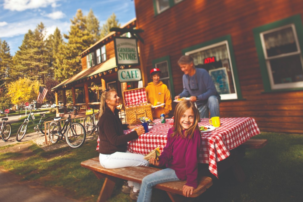 A family enjoying a picnic with food and drinks from Camp Richardson's General Store & Deli in South Lake Tahoe.