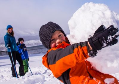 child holding giant snowball