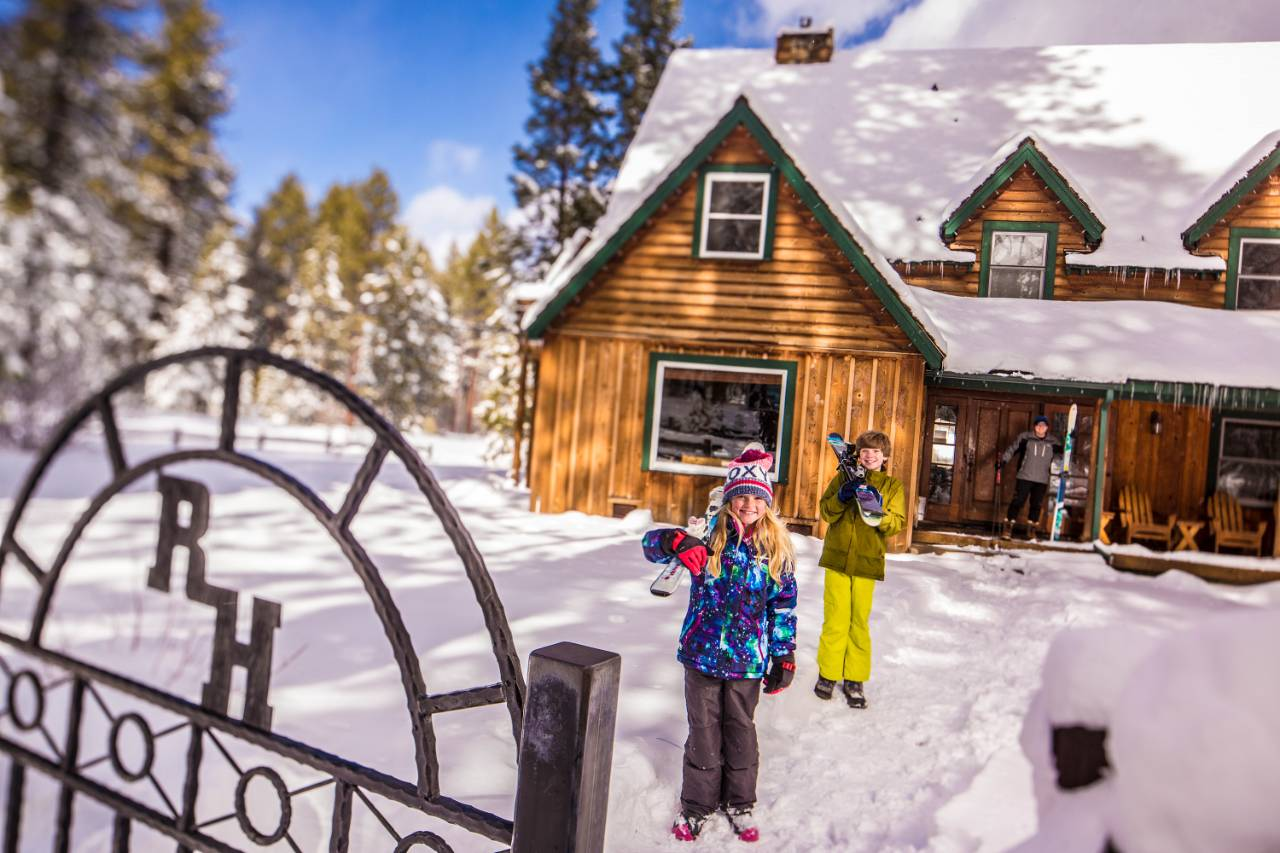 A family with rented downhill skiing equipment outside the Richardson House in South Lake Tahoe.