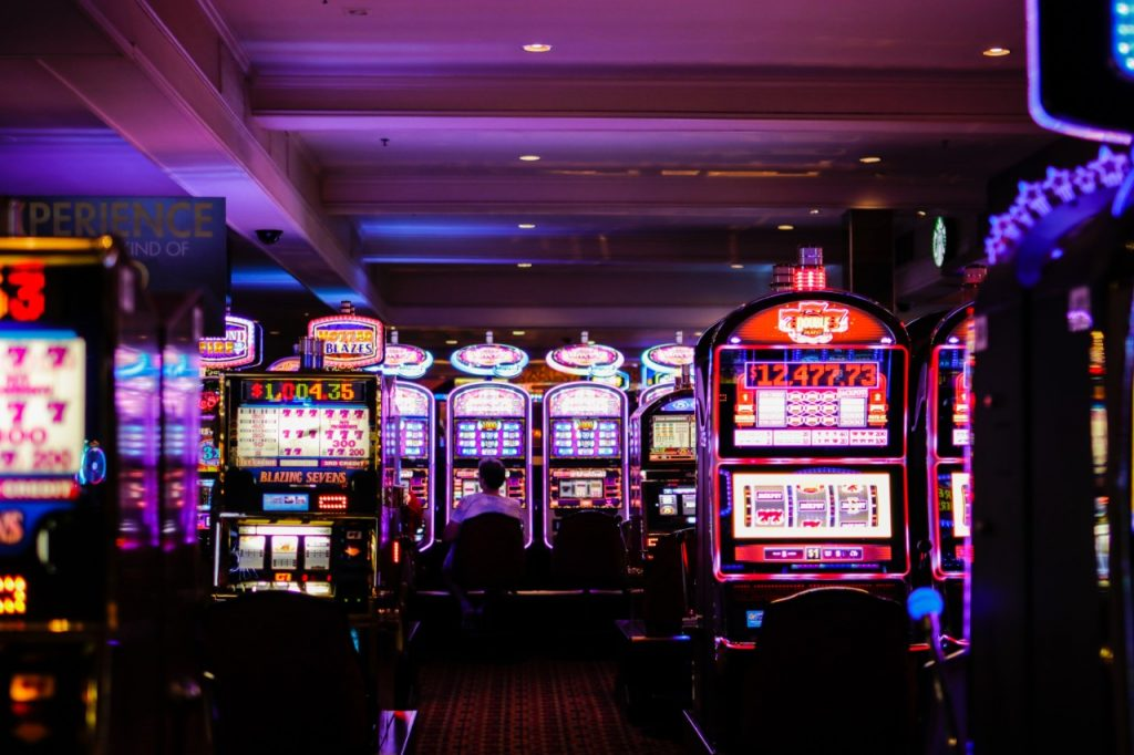 playing slot machines in a casino