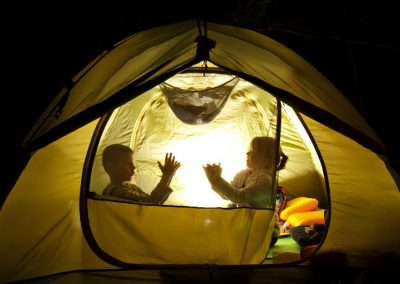 children playing in a tent at night