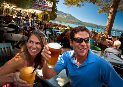 man and woman having drinks at lake tahoe