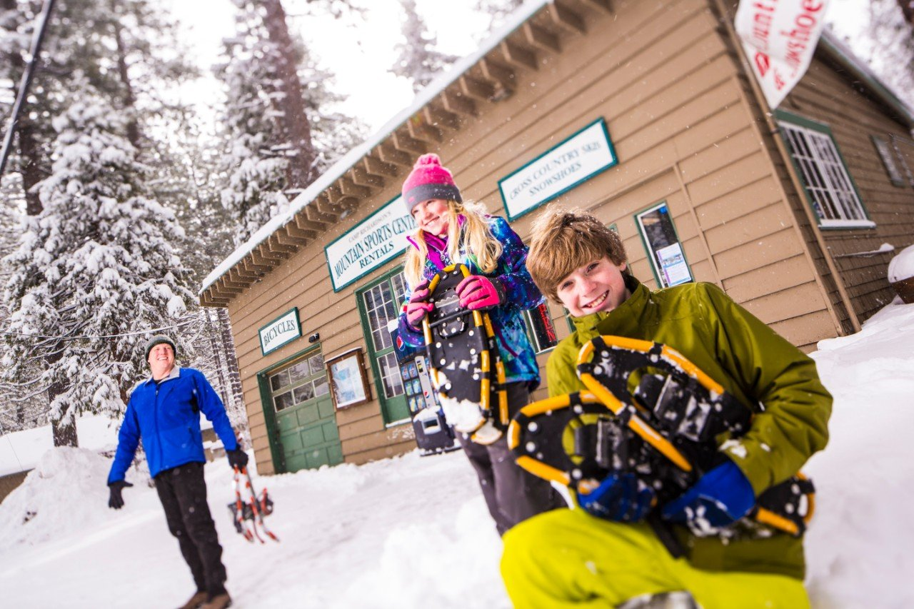 A family with snowshoe rentals from Camp Richardson's Mountain Sports Center.
