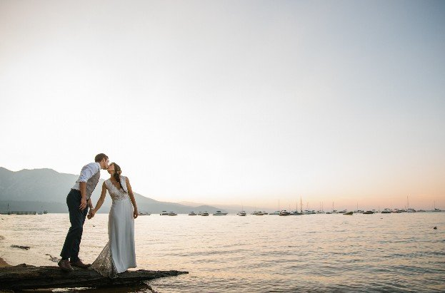 bride and groom on a pier at lake tahoe