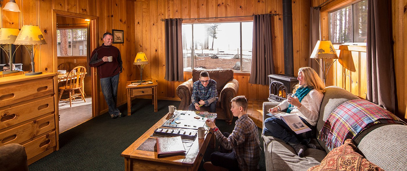A family relaxing in a rustic Lake Tahoe cabin rental at Camp Richardson.